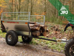 preprava dlhších kusov dreva na prívese Farmár